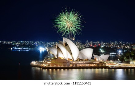 SYDNEY, AUSTRALIA - MARCH 8, 2018 - A big green ball of fireworks bursts against the night sky over the Sydney Opera House