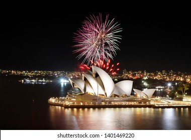 Sydney, Australia - March 8, 2018 - Colorful bursts of fireworks fill the night sky at the Sydney Opera House