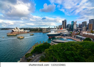 SYDNEY, AUSTRALIA - MARCH 9, 2018 - Ferries hustle in and out of the docks at Circular Quay in Sydney Harbor