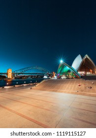 Sydney, Australia - May 11, 2018: View of Sydney Opera House and Harbour Bridge with clear blue sky at night.