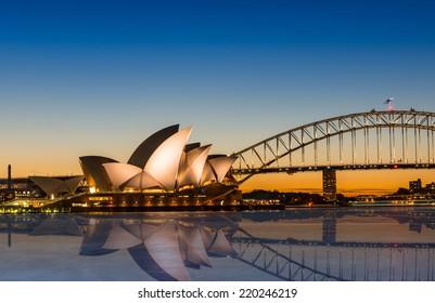 Sydney, Australia - May 16, 2014: The Sydney Opera House with Harbour bridge in Sydney Australia, Designed by Danish architect Jorn Utzon