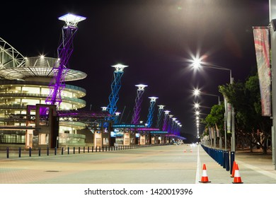 Sydney, Australia - May 2, 2019: Empty street view in front of ANZ Stadium at Sydney Olympic Park at night.