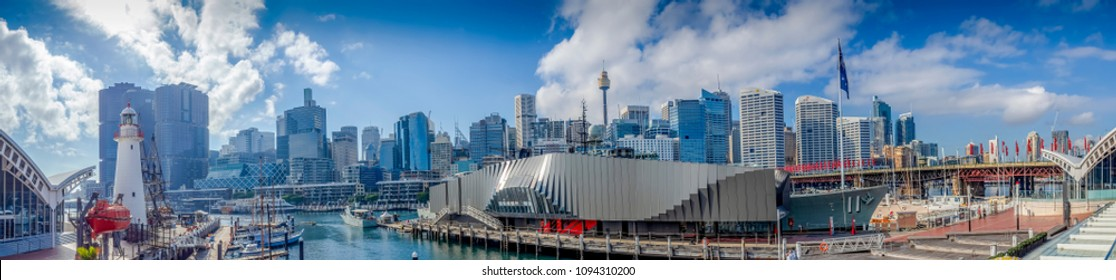 Sydney, Australia - May 22, 2017: Panorama view at the Australian National Maritime Museum, overlooking Pyrmont Bay. Features lighthouse, moored boats and modern high-rise buildings.