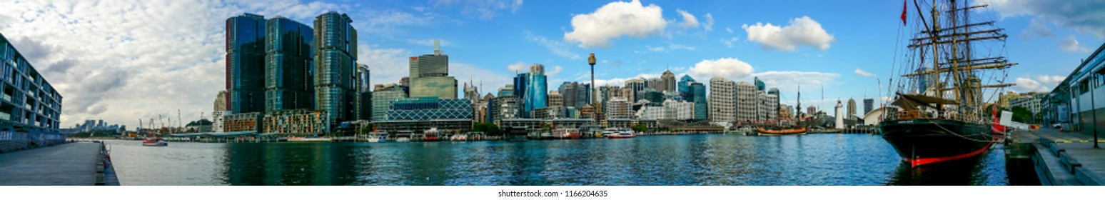 Sydney, Australia - May 22, 2017: Panorama view of the city skyline from Pyrmont Bay. Restored Tall Ship James Craig (1874) moored to the pier at Sydney Heritage Fleet (right).
