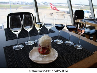 SYDNEY, AUSTRALIA – MAY 23 2014: Qantas serves its signature dessert, Pavlova in a Glass, for first class passengers in the Qantas Sydney First Class Lounge, where wine tastings are also offered.