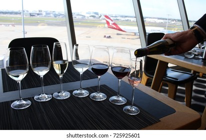 SYDNEY, AUSTRALIA – MAY 23 2014: Qantas offers a wine tasting experience for its first class passengers in the Qantas First Class Lounge at Sydney Airport's international terminal.