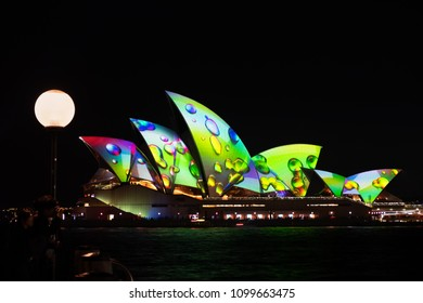 Sydney, Australia - May 25 2018: Tourists taking in the Sydney Opera House lights on the opening night of Vivid Sydney 2018