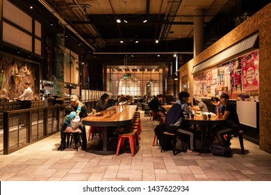Sydney, Australia - May 27, 2019: People eating at Chatswood Interchange food court.