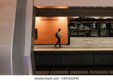 Sydney, Australia - May 27, 2019: A woman standing at Chatswood train station platform.