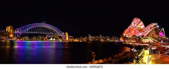 SYDNEY, AUSTRALIA - May 29, 2016, Panorama of Sydney Opera House and harbour bridged illuminated with colourful light design imagery, during the Vivid Sydney 2016 annual public event.