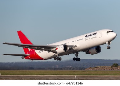 Sydney, Australia - May 5, 2014: Qantas Boeing 767 airliner taking off from Sydney Airport.