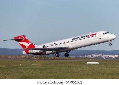 Sydney, Australia - May 5, 2014: QantasLink (Qantas) Boeing 717 regional jet airliner taking off from Sydney Airport.