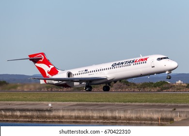 Sydney, Australia - May 5, 2014: QantasLink (Qantas) Boeing 717 regional jet airliner taking off from Sydney Airport.