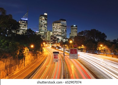 SYDNEY, AUSTRALIA - MAY 5, 2017: Trails of car lights with Sydney cityscape at the background.