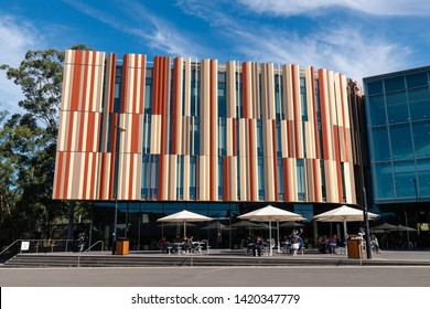 Sydney, Australia - May 9, 2019: Front view of Macquarie University Library cafe with umbrella stand.