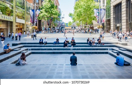 Sydney, Australia - Nov 14, 2017: A view of the iconic Martin Place; a pedestrian mall flanked by large financial cooperations. Features people walking about and those relaxing and having lunch.