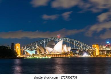 Sydney, Australia - Nov 14, 2017 : Sydney harbor skyline at night with Sydney harbor bridge and opera house, NSW, Australia.