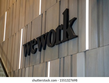 Sydney, Australia - Nov 2, 2019: The WeWork logo at the entrance to a WeWork co-working space location in downtown Sydney. WeWork provides shared workspace, community, and services.