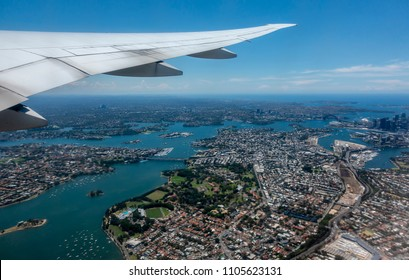 Sydney, Australia - Nov 23, 2017: Delta Airlines Flight DAL40 takes off out of Kingsford-Smith International Airport en-route to Los Angeles, USA. Surrounding suburbia below, including Sydney Harbor.