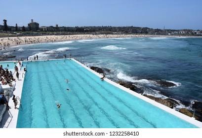 Sydney, Australia - Nov 4, 2018. People relaxing at Bondi Iceberg swimming pool on a hot sunday in Spring time. Bondi beach, Sydney, NSW, Australia.