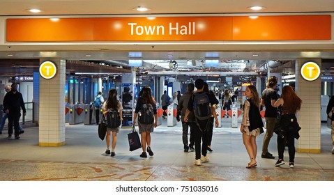 Sydney, Australia - November 03, 2017: Passengers hurry into Town hall train station underground entrance from the Queen Victoria Building.