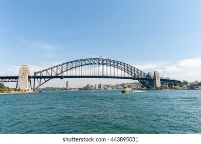 SYDNEY, AUSTRALIA - NOVEMBER 05, 2014: Sydney Architecture and Harbou Bridge with ferry. Wide Angle.
