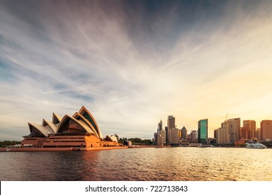 Sydney, Australia - November 10, 2015:  Opera House with Sydney city skyline at sunset. View from ferry approaching Circular Quay.