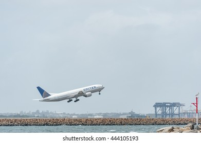 SYDNEY, AUSTRALIA - NOVEMBER 11, 2014: Sydney International Airport With Take Off Airplane. Aircraft N220UA, Boeing 777-222, United Airlines