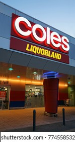 Sydney, Australia - November 13, 2017: Coles supermarket and  Liquorland neon signboards near shop entrance in Edgecliff. Liquorland is an Australian liquor chain, a part of the Coles Liquor division.