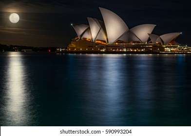 Sydney, Australia - November 15, 2016: The bright supermoon and the reflections in the water make the gorgeous architecture of Sydney Opera House look even more majestic.Artistic concept.