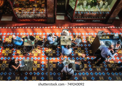 SYDNEY, AUSTRALIA - November 2, 2017: People enjoying a coffee at the Strand Arcade, a multi-level Victorian-style gallery with a glass roof, a historical site with shops and restaurants in Sydney CBD