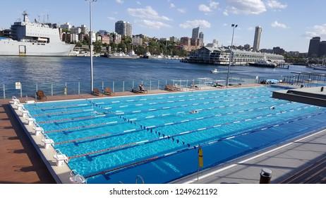 "SYDNEY, AUSTRALIA - NOVEMBER 22, 2018: Andrew ""Boy"" Charlton Pool is is an eight-lane outdoor heated salt-water 50-metre swimming pool on the shore ofWoolloomooloo Bayin the City of Sydney."