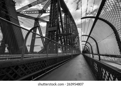 SYDNEY, AUSTRALIA - NOVEMBER 23, 2014: Black and white image of the view of the pedestrian walkway on the famous Sydney Harbour Bridge in November 2014.