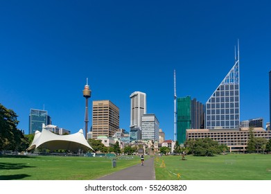 Sydney, Australia - November 24, 2016: Sydney Domain, public space with tent stage and Sydney CBD skyline on the background