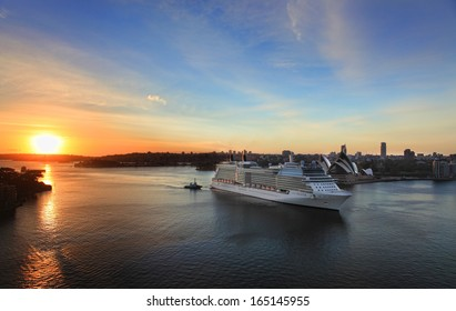 SYDNEY, AUSTRALIA - NOVEMBER  28, 2013:  Celebrity Solstice, one of Australia's highest rated superliners sails into Sydney Harbour at sunrise.