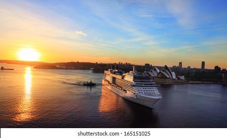 SYDNEY, AUSTRALIA  - NOVEMBER 28, 2013:  Celebrity Solstice, luxury cruise ship, sails into Sydney Harbour Circular Quay at sunrise. Focus to ship