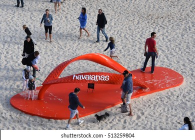 Sydney, Australia - Oct 23, 2016. Big red havaianas thongs on Tamarama beach.  Sculpture by the Sea  is one of the largest free to the public sculpture exhibitions.
