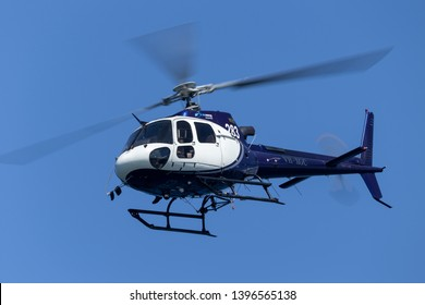 Sydney, Australia - October 11, 2013: Eurocopter AS 350B3 Helicopter VH-XGC conducting aerial filming over Sydney Harbour.