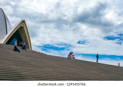 Sydney, Australia - October 17, 2014:  Tourists on the flight of steps of the Opera House