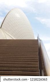 Sydney, Australia - October 20, 2018: Close up of sail of Sydney Opera House with nobody on stairs, blue sky and clouds as background.