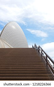 Sydney, Australia - October 20, 2018: Close up of sail of Sydney Opera House with nobody on empty stairs and handrail, blue sky and clouds as background.