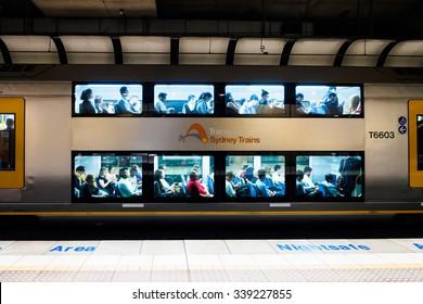 Sydney, Australia - October 22, 2015: Passengers taking Sydney train in the airport terminal.