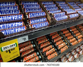 SYDNEY, AUSTRALIA - OCTOBER 3, 2017: Snickers and Mars chocolate bars on store shelf. Snickers and Mars is a brand name chocolate bar made by the American company Mars, Incorporated.
