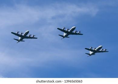 Sydney, Australia - October 5, 2013: Formation of three Royal Australian Air Force (RAAF) Lockheed AP-3C Orion maritime patrol and anti-submarine warfare aircraft.