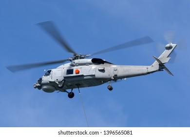 Sydney, Australia - October 5, 2013: Royal Australian Navy (RAN) Sikorsky S-70B-2 Seahawk Helicopter N24-005 over Sydney Harbour.