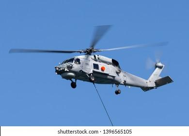 Sydney, Australia - October 5, 2013: Royal Australian Navy (RAN) Sikorsky S-70B-2 Seahawk Helicopter N24-001 over Sydney Harbour.