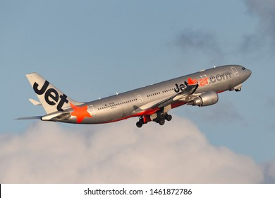 Sydney, Australia - October 7, 2013: Jetstar Airways Airbus A330 twin engine wide body passenger aircraft taking off from Sydney Airport.