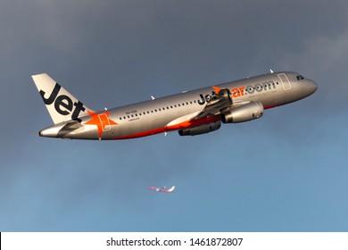 Sydney, Australia - October 7, 2013: Jetstar Airways Airbus A320 twin engine passenger aircraft climbing on departure from Sydney Airport.