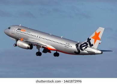 Sydney, Australia - October 7, 2013: Jetstar Airways Airbus A320 twin engine passenger aircraft departing Sydney Airport.