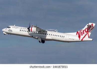 Sydney, Australia - October 7, 2013: Virgin Australia Airlines ATR ATR-72 twin engine turboprop regional airliner aircraft taking off from Sydney Airport.